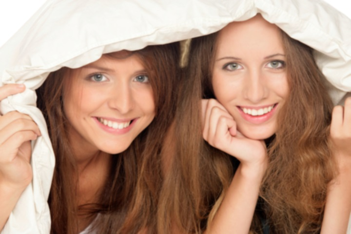 http://www.dreamstime.com/royalty-free-stock-photography-girls-below-duvet-image13299897